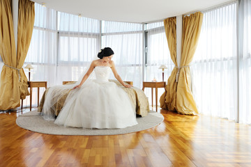 Beautiful bride in a hotel room