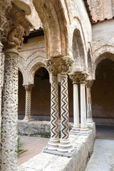 Capitels, columns and arches in Monreale cloister Sicily