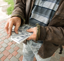 Farmers hands holding pack of money