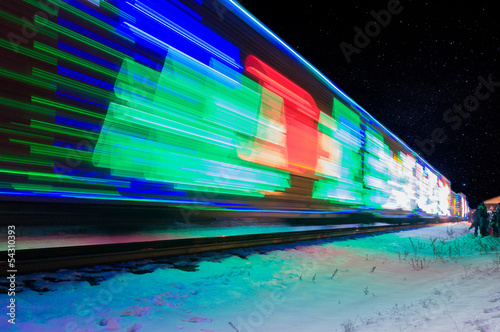 Train Decorated with Holiday Lights Arrives at Station