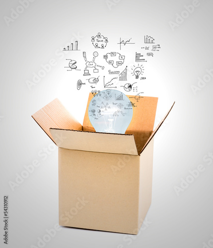 Glowing light bulb over open cardboard box with business graph
