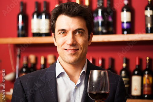 Sommelier tasting a wine glass