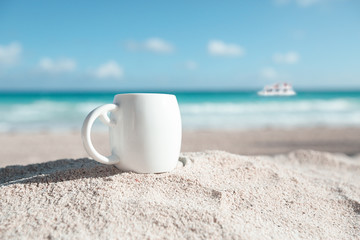 white espresso coffee cup with ocean , beach and seascape