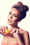 Beautiful fashion girl with mandarin