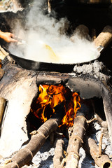 Boiling of the palm sugar.