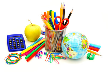 Colorful collection of various school supplies over white
