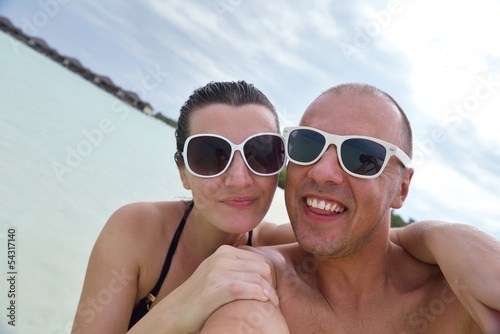 happy young  couple at summer vacation have fun and relax at bea