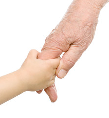 old man and a kid holding hands together. isolated on white back