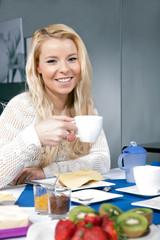 Pretty woman enjoying her breakfast