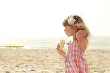 Child with ice-cream on the sea