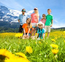 Kids in the mountains flower field