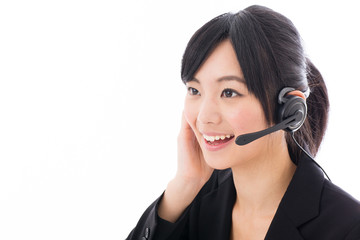 young asian businesswoman with headset talking