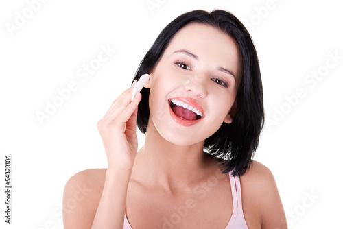 Young beautiful caucasian woman using a cotton pad