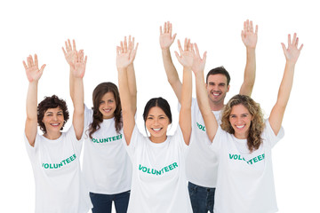 Group of volunteers raising arms