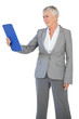 Businesswoman looking at clipboard
