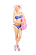 Full length portrait of an attractive blond woman in swimsuit