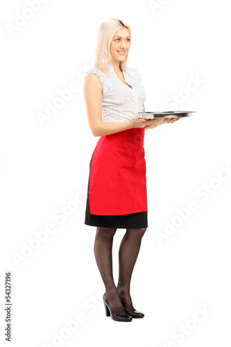 Full length portrait of a smiling blond female waitress holding