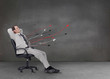 Attractive businessman relaxing on his chair