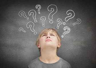 Thinking child looking at question marks