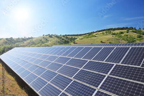 Solar photovoltaic cell panels under sunny sky - 54327330