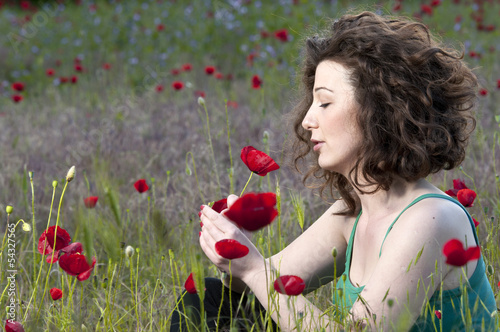 Portrait of beautiful woman holding flower