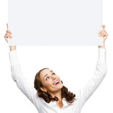 Happy businesswoman showing blank signboard