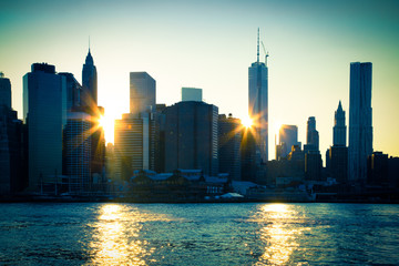 Lower Manhattan with sun flares through buildings