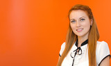 Portrait of young pretty woman on orange background