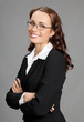 Smiling businesswoman, over gray