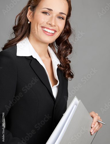 Businesswoman with folder, on gray