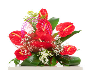 Basket of red anthurium flowers
