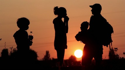 Young family on vacation at sunset,walk at sunset