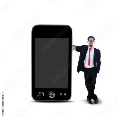 Businessman and large smartphone - isolated