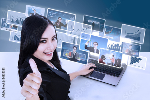Businesswoman give thumbs up on online pictures