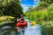 canvas print picture - Frau paddelt im Kanu