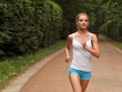 Woman Runner. Fitness Girl Running outdoors