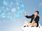 Happy businessman sitting on cloud with cloud computing