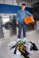 Man Holding Empty Basket With Dirty Clothes On Floor