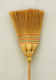 Whisk broom standing at wall