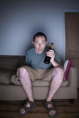 man watching tv in disbelief