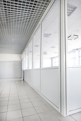 Empty office room with glass walls