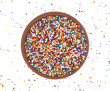 Candy sprinkles in bowl with scattering of sprinkles