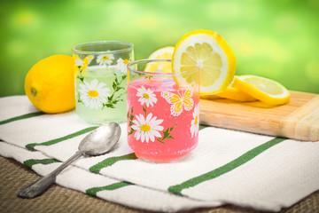 Arrangement of pink lemonade and lemons outside