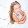six year old girl in a white bed