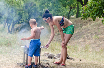 Young boy helping at the barbecue