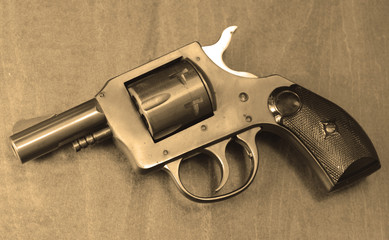small pistol in sepia