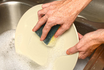 cleaning plate while doing dishes