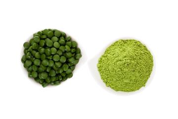 Healthy living. Spirulina pills and wheatgrass.