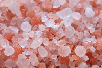Background texture of natural Himalayan pink rock salt.
