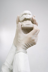 Dental Casting - hands holding dental gypsum models / Dental Con